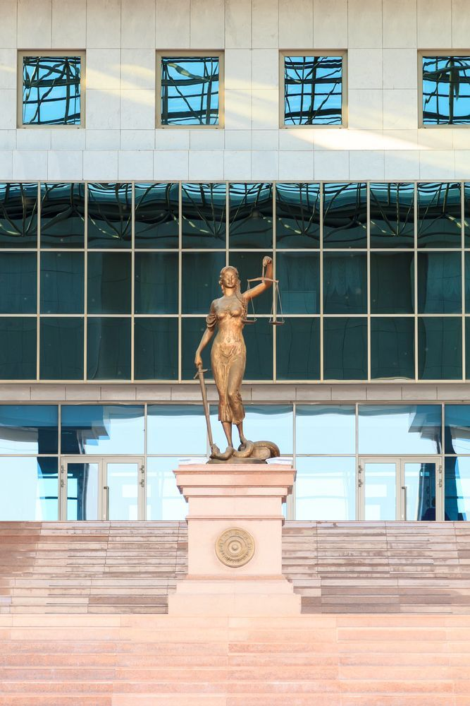 Statue at the entrance to the Supreme Court of Kazakhstan (Depositphotos)