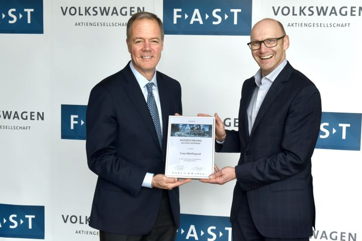 CEO, Gregg Lowe stands with Mr. Baecker, Head of Volkswagen Purchasing Connectivity during Volkswagen Group's FAST partner selection ceremony held internally at their Wolfsburg, Germany headquarters on May 10.